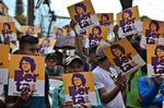 Members of the Council of Popular and Indigenous Organizations of Honduras (COPINH) hold posters with an image of slain indigenous leader and environmental activist Berta Cáceres at a demonstration inTegucigalpa, Honduras, on Oct. 10, 2019.