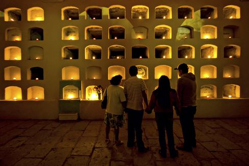 Paying respects at the candle-lit crypt of San Miguel in Oaxaca.