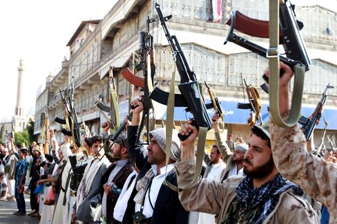 Tribal gunmen loyal to the Huthi movement brandish their weapons in the capital Sanaa on April 1, 2015.