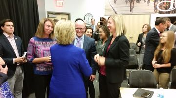Hillary clinton talks with des moines register employees after her editorial board meeting on sept. 22, 2015.