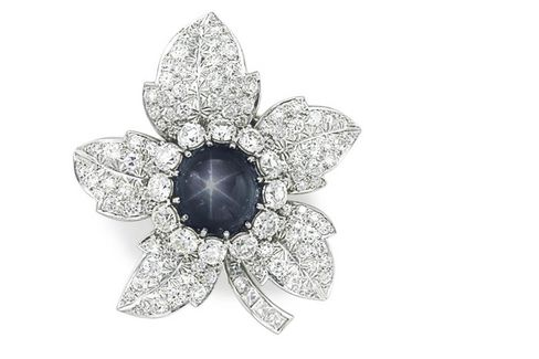 A sapphire and diamond brooch.