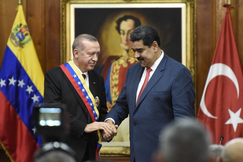 Recep Tayyip Erdogan meets with Nicolas Maduro at the presidential palace in Caracas on Dec. 3, 2018.