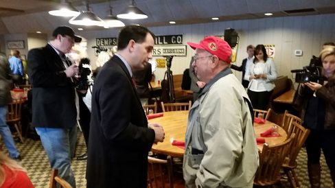 Governor Scott Walker speaks with an Iowa resident in suburban Des Moines on April 25, 2015.
