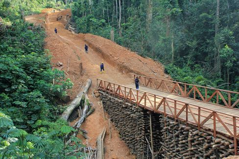 Workers for Alphamin Bisie Mining, a unit of Alphamin Resources Corp., build a 32 kilometer access road to the Bisie tin deposit by hand through the jungle in Walikale territory, eastern Democratic Republic of Congo.