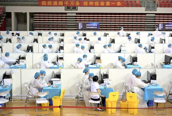 China Pushes Vaccine on Bankers, Colleges to Catch Up With U.S.