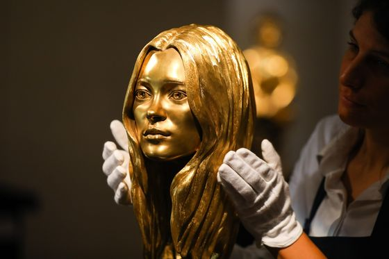 Gold Ferrari, Kate Moss Bust Offered at 'Midas Touch'Auction