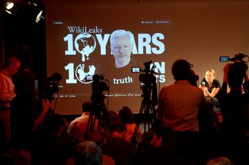 Assange participates via video link at a news conference with WikiLeaks journalist Sarah Harrison (right) in Berlin on October 4.