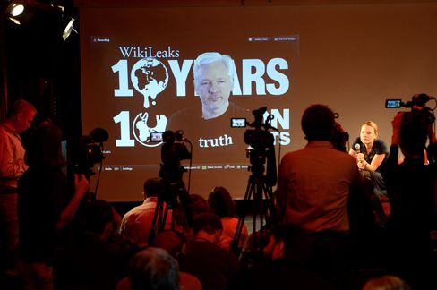 Assange participates, via video link, at a news conference with WikiLeaks journalist Sarah Harrison (right) in Berlin on Oct. 4, 2016.
