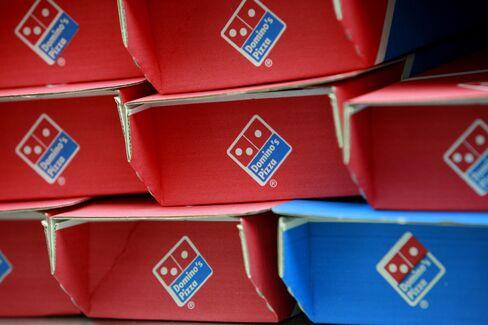 Domino's Rises as International Sales Fuel Profit: Detroit Mover