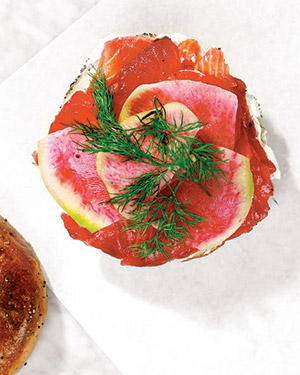 """Beet juice turns the salmon a bright pink. Watermelon radishes aren't as bitter as regular ones, """"and they're beautiful,"""" Kliegman says"""