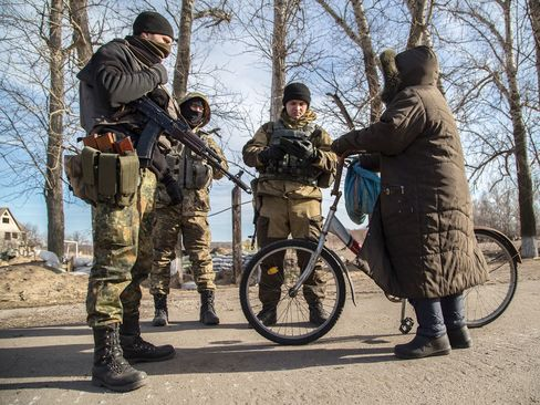 Ukrainian servicemen check documents of a local resident at a checkpoint near Slavyanoserbsk, in the region of Lugansk on Feb. 25, 2015.