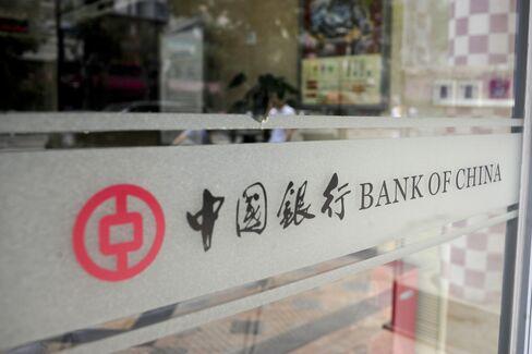 China's Stocks Rise on Earnings Growth, U.S. Economic Data