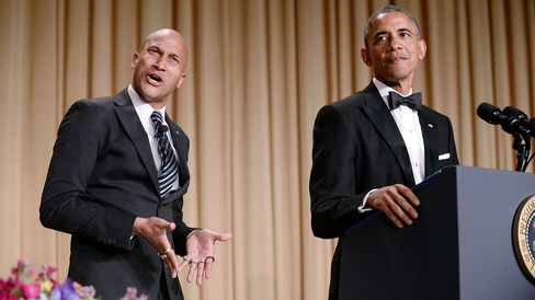 Comedian Keegan-Michael Key gestures as President Barack Obama speaks at the White House Correspondents' Association dinner on April 25, 2015, in Washington.