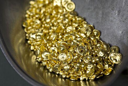 Gold Bulls Expand as Billionaire Paulson Says Buy