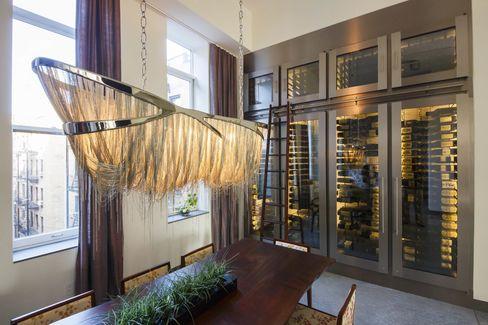 Joseph &Curtis recently designed this 500-bottle cellar to fit into a 14-by-10-foot niche in a modern art-filled apartment on 23rd Street in New York City's Chelsea district. It's sleek and elegant and offers the owner—and his friends—a way to ogle his bottles while dining.