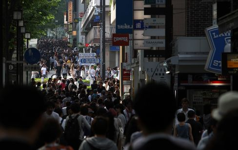Japan Raises Economic Assessment for First Time in Nine Months