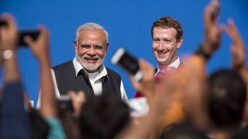 Narendra Modi, India's prime minister, left, and Mark Zuckerberg, chief executive officer of Facebook Inc., at the conclusion of a town hall meeting at Facebook headquarters in Menlo Park, California, on Sept. 27, 2015. P