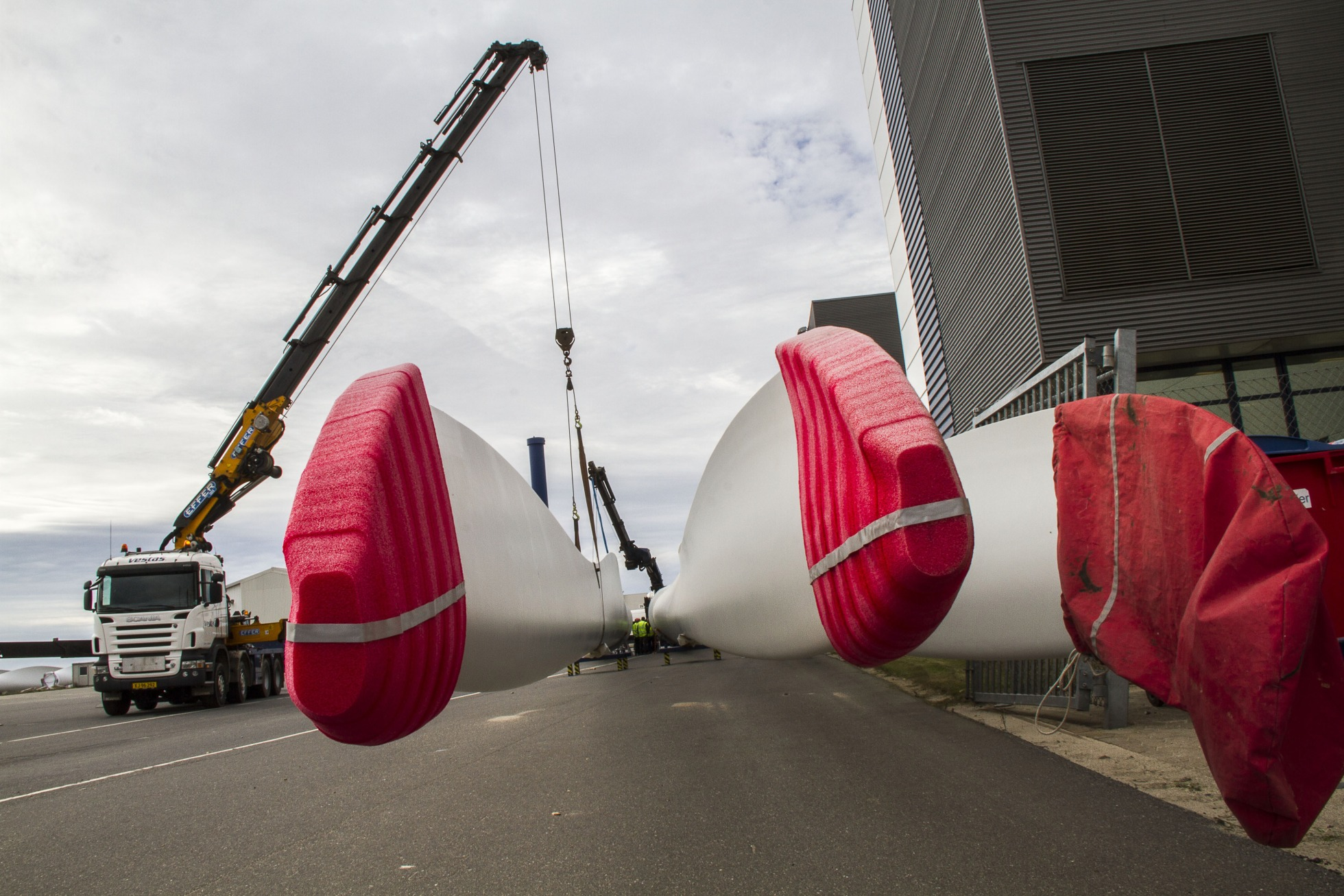 Protective covers sit on wind turbine blades as they are moved at the Vestas Wind Systems A/S blade factory in Lem.