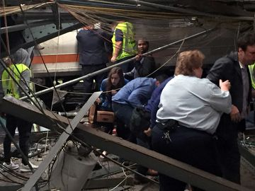 Passengers rush to safety after a NJ Transit train crashed in to the platform at the Hoboken Terminal September 29