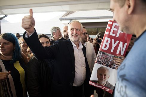 Corbyn arrives to the Labour leadership contest debate with Owen Smith.