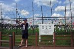A man takes a selfie in front of a sign board showing the distance to Gaeseongnear the DMZ.