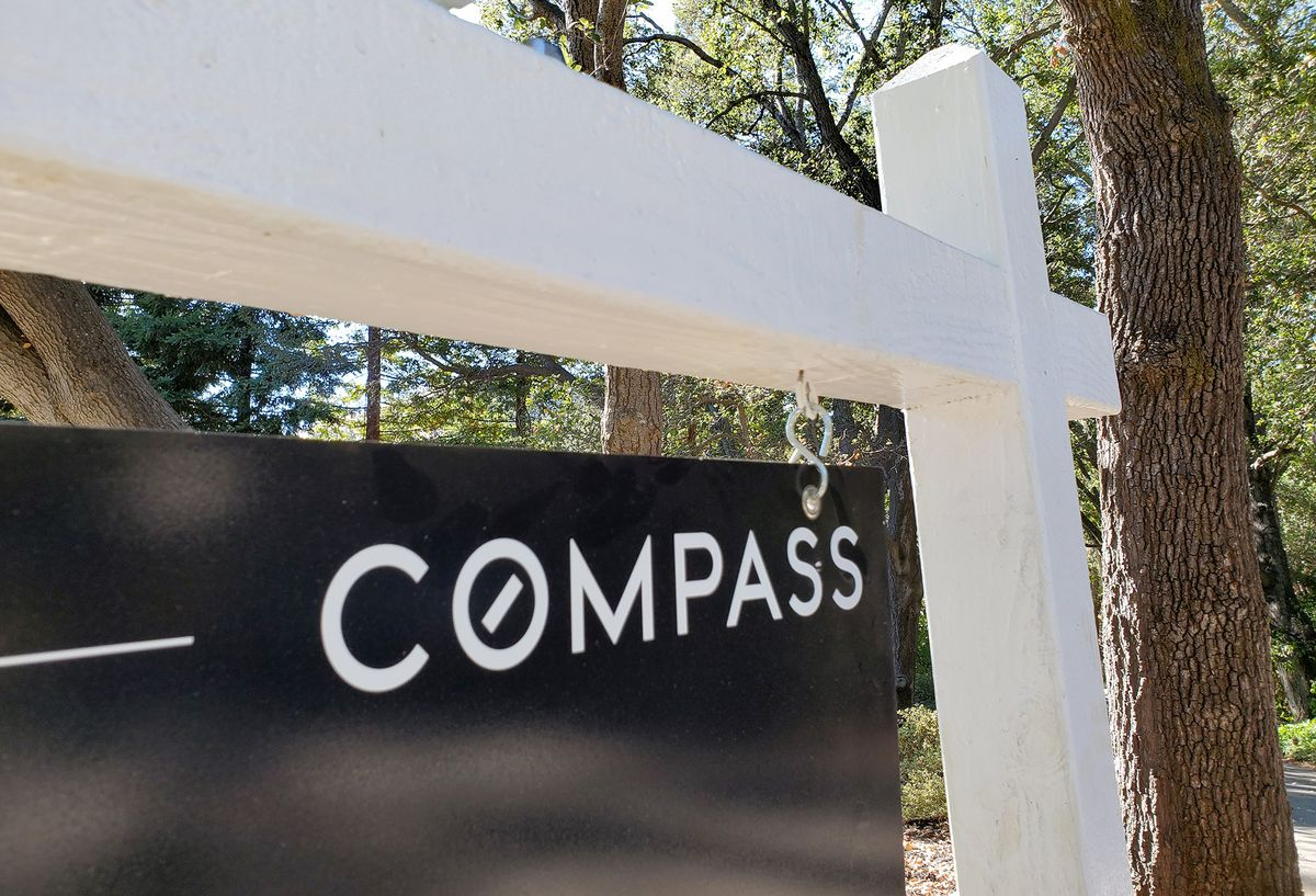SoftBank-Backed Real Estate Firm Compass Cuts IPO by Half