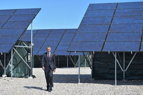 Obama walks to the lectern to speak about clean energy jobs at Hill Air Force Base in Utah in 2014.