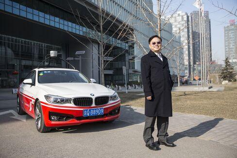 Wang Jing poses next to Baidu's autonomous car at the company headquarters in Beijing.