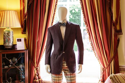 """A lilac linen sports coat and wool check trousers featured in the """"Savile Row and America"""" exhibition."""