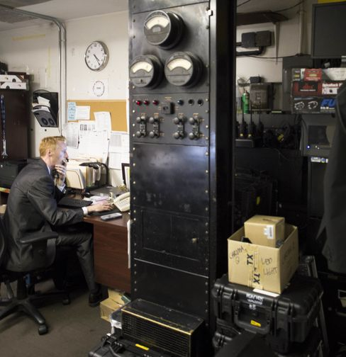 A Waldorf Astoria employee works amid audio relics from the 1930s.