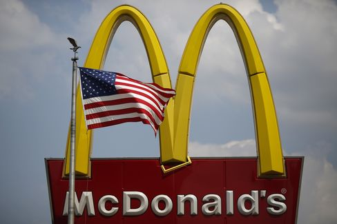 A U.S. Flag Flies in Front of McDonald's Signage