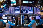 Trading On The Floor Of The NYSE While Stocks Fluctuate As Utilities Offset Retail Slump
