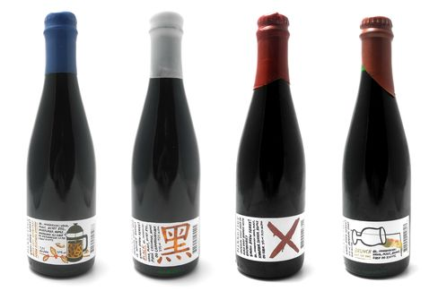"""A selection of bottles from Mikkeller's rare """"Small Brew Series!"""" featuring artwork by Keith Shore."""