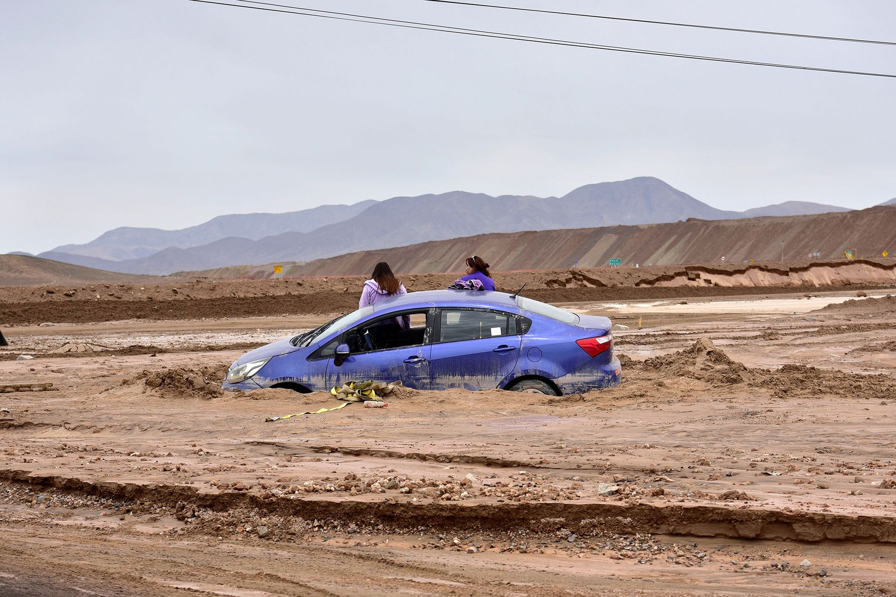 A car sits trapped in mud in Chuquicamata, Chile, on Feb. 7, 2019.