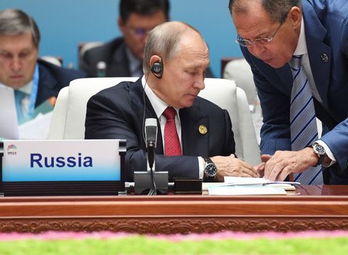 XIAMEN, CHINA - SEPTEMBER 5, 2017: Russia's President Vladimir Putin listens to Russia's Foreign Minister Sergei Lavrov (L-R) at a meeting of the leaders of the BRICS member states and states invited to the 2017 BRICS Summit in the city of Xiamen. Grigory Sysoyev/Russian Presidential Press and Information Office/TASS (Photo by Grigory Sysoyev\TASS via Getty Images)