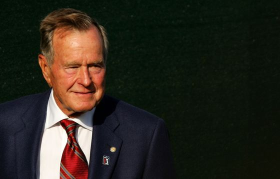 George H.W. Bush's Death Spurs Tributes From Clintons to Trump