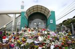Flowers cover the steps of the Kilbirnie Mosque on March 17.