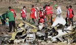 Forensics investigators and recovery teams collect personal effects and other materials from the crash site of Ethiopian Airlines Flight ET 302.