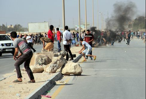 Libya Unrest Leaves 31 Dead as Protests Demand Militia Curbs