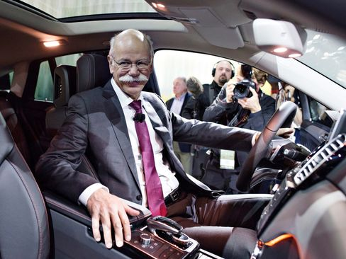 Dieter Zetsche, chief executive officer of Daimler, sits in the front seat of a Mercedes-Benz GLE 450 AMG Sport Coupe.
