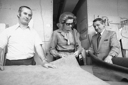 Princess Grace of Monaco visits the cutting room at Vera Maxwell Inc., at New York City's Garment District Showrooms on April 30, 1974. Manager David Lebowitz looks on at right.