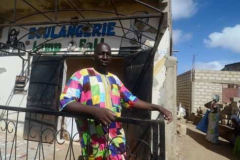 Ndiasse Dieng in front of his bakery in the city of Thies, Senegal.