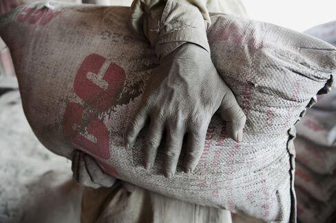 Laborer Carries Cement Bag At Shakur Basti Station
