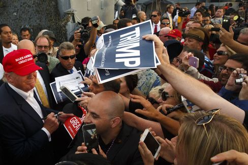 Donald Trump signs autographs for supporters after a rally aboard the Battleship USS Iowa in San Pedro, California, on Sept. 15.