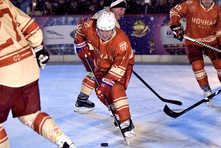 Russian President Vladimir Putin on the ice at a night hockey match in Moscow.