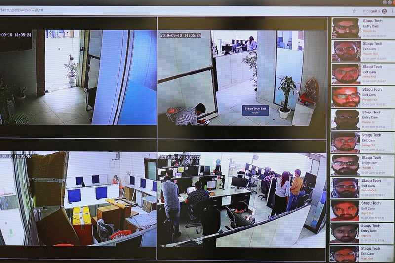 Employees displays a facial recognition identity system installed / acquired by various security agencies of India developed by the  security system solution developer Staqu's at its headquarters  in Gurugram, Haryana, on the outskirts of New Delhi, India