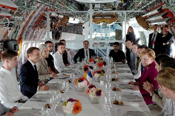 Macron, Merkel Make a Show of Unity With Tour of Airbus Factory