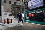 A pedestrian walks along Wall Street near the New York Stock Exchange (NYSE) in New York, U.S.