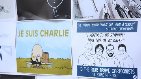 Members of the Media Entertainment and Arts Alliance remember victims of the Paris Massacre by creating a memorial wall of cartoons at Chalmers Street Redfern on January 8, 2015 in Sydney, Australia.