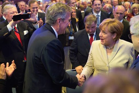 Former Florida Governor Jeb Bush greets German Chancellor Angela Merkel at the CDU Economics Conference of the Economic Council on Tuesday.